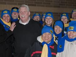 Brian Dunn posed for a photo with the first shoppers in line at Best Buy for Black Friday holiday deals Nov. 25, 2011 in Eden Prairie, Minn.
