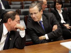 Federal Housing Finance Agency Acting Director Edward DeMarco, left, talks with Fannie Mae CEO Michael Williams before testifying before the House Financial Services Committee's Oversight and Investigations Subcommittee in December 2011, in Washington, D.C.