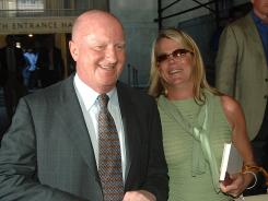 Former Tyco Chairman Dennis Kozlowski, left, and his wife Karen leave New York Criminal Court in May 2005. He was convicted on charges he looted millions of dollars from the company.