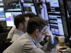 Traders work on the floor at the New York Stock Exchange in New York on March 6, 2012.