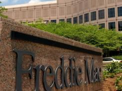 The Freddie Mac sign at its headquarters in McLean, Va. The nation's largest holder of mortgages reports loan rates weekly.