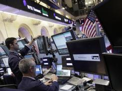 Traders work on the floor of the New York Stock Exchange on Feb. 24, 2012.