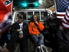 Stephen Martin, from left, Whitney Mart and Zach Bond in the bed of a pickup March 23 during a night of cruising in Fort Collins, Colo.