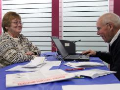 To cope with budget cutbacks, the IRS is working more closely with volunteer tax preparation groups to provide one-on-one assistance for taxpayers. Marion Caffrey receives help with her taxes for free by Voluntary Action Center volunteer George Moritz at The Steamtown Mall in Scranton, Pa., during a free tax service for people over 60 years old.