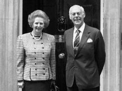 Prime Minister Margaret Thatcher, wearing an Aquascutum suit, with her husband Denis outside 10 Downing Street in 1987.