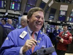 Trader Stephen Mara works on the floor of the New York Stock Exchange April 17, 2012.