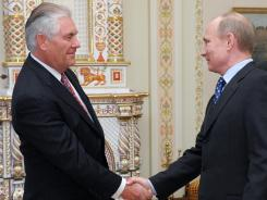 Rex Tillerson, chairman of ExxonMobil, left, shakes hands with Russian Prime Minister Vladimir Putin in the Novo-Ogaryovo residence April 16, 2012.