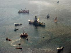 The Transocean Discoverer Enterprise drill ship, center right, collects oil from the site of the BP Deepwater Horizon spill June 12, 2010.