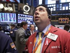 Trader Michael Capolino works on the floor of the New York Stock Exchange on April 17, 2012.