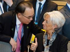 The IMF's Christine Lagarde chats Friday with a South Korean official at the G20 ministerial meeting in Washington.