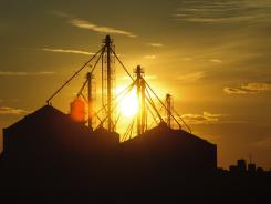 Sun sets on the grainery at the Frahm Farms headquarters near Colby, Kan., in February 2012.