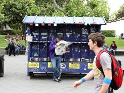 A UC Berkeley student reads a student newspaper while standing in Sproul Plaza on campus April 23, 2012 in Berkeley, Calif.