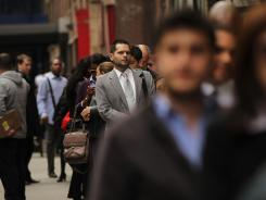 Potential applicants line-up for an April 18 job fair in New York City.