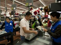A man pays at the cash register of a Wal-Mart Superstore in Mexico City on Nov. 18, 2011.