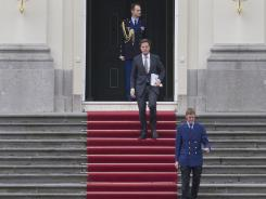 Dutch prime minister Mark Rutte, center, leaves royal palace Huis ten Bosch after meeting with Dutch Queen Beatrix in The Hague, Netherlands, on April 23, 2012.