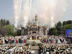 No, they're not celebrating this deal. This 2005 photo shows festivities for the 50th anniversary of Disneyland in California.