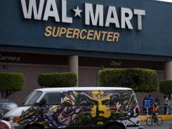 A van covered by a mural sits parked outside a Walt-Mart Super Center in Mexico City, on April 21, 2012.