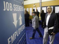 Job seeker Alan Shull, of Portland, at a job fair Tuesday in Portland, Ore. A USA TODAY panel of 50 economists expects the jobless rate to fall to 8% by year's end.