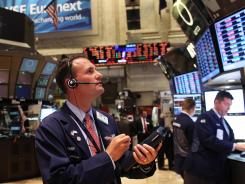 Traders work on the floor of the New York Stock Exchange on April 23, 2012.