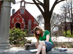 University of Dubuque student and adjunct instructor Jennifer Hogue takes a break on campus in Dubuque, Iowa. The state's college students graduate with some of the nation iacute/>s highest debt.