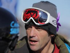 Trennon Paynter, ski coach for team Canada, wears Smith Optics goggles in this photo. The red writing and purple ribbon are in memory of Canadian skier Sarah Burke, who died Jan. 19, 2012 from injuries sustained in a training accident.