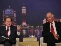 Las Vegas Sands' Sheldon Adelson, left, and Michael Leven attend a news conference April 12 in Macau.