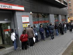People line up to enter a government employment office in Madrid, April 27, 2012.