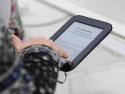 A customer tries out a Nook Simple Touch at the Barnes & Noble store in Tysons Corner, Va. in this file photo.