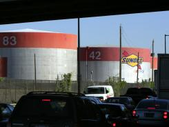Motorists pass the Sunoco refinery in Philadelphia in this file photo.