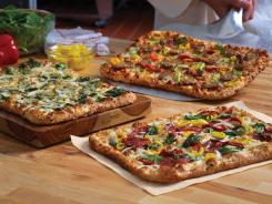 Domino's Artisan Pizza flavors: Spinach & Feta, Italian Sausage & Pepper Trio and Tuscan Salami & Roasted Veggie.