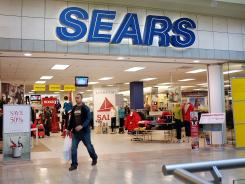 A man walks out of a Sears store on Dec. 27, 2011 in Milford, Conn.