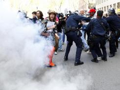 Protesters are tear gased during a Tuesday rally for International Worker's Day in Oakland.