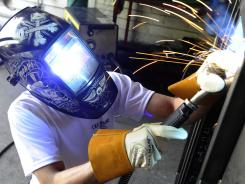 Justin Stuhr works as a welder at Ole Hickory Pits in Cape Girardeau, Mo. A veteran, he was hired through Missouri's Show-Me Heroes program, which has placed 1,500 veterans.