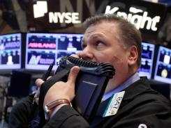 George Ettinger works on the floor of the New York Stock Exchange in this April 25, 2012 photo.