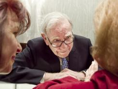 Warren Buffett talks with Berkshire Hathaway shareholders in 2011.