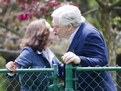 Conrad Black kisses wife Barbra Amiel Black as he arrives Friday at his Toronto home after his prison term.