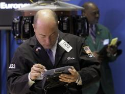 Trader Christopher Morie works on the floor of the New York Stock Exchange, April 9, 2012.