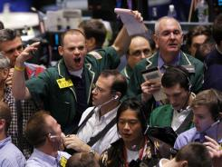 Traders work the crude oil pit at the New York Mercantile Exchange in this file photo.