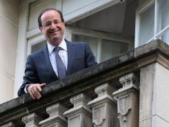 French President-Elect Francois Hollande appears Monday on the balcony of Socialist Party headquarters in Paris.