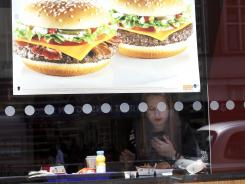 A woman sits in a McDonald's restaurant in London on April 30, 2012.