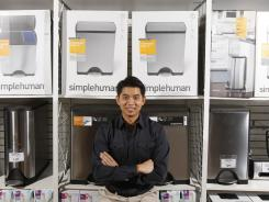 Frank Yang, founder and lead designer of simplehuman, stands in front of a display of his products at a Bed Bath and Beyond in Hawthorne, Calif.