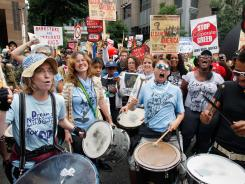 Bank of America protesters Wednesday at the intersection of College and Fifth Streets in Charlotte.