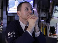 Specialist Stephen Naughton works on the floor of the New York Stock Exchange May 8, 2012.