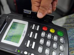 Retailers are paying much less in debit card fees since the swipe fee cap rule went into effect, according to a recent Federal Reserve report.