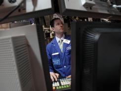 Specialist Stephen D'Agostino works at his post on the floor of the New York Stock Exchange May 7, 2012.