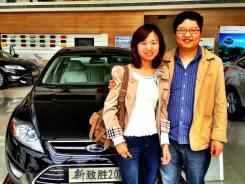 Juan Lu and husband Jun Gao pick up their first new car, a Ford Mondeo, from a dealership in Beijing.