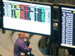 An oil trader works on the floor of the New York Mercantile Exchange on May 11, 2012 in New York City.