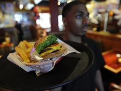 Taaron Nichols delivers a Tavern Double Burger at s Red Robin in Valencia, Calif.