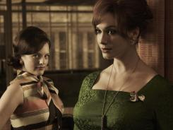 "Elisabeth Moss as Peggy Olson, left, and Christina Hendricks as Joan Harris in TV's ""Mad Men."""