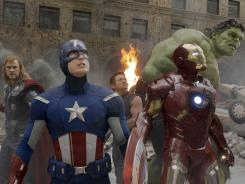 "Thor (Chris Hemsworth), Captain America (Chris Evans), Hawkeye (Jeremy Renner), Iron Man (Robert Downey Jr.), and Hulk (Mark Ruffalo) in a scene from the motion picture ""The Avengers."""